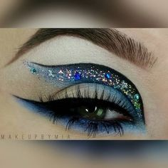 SWOONING over this perfect and dramatic blue glitter look by @makeupbymia  Details: Dark Brown Brow Pencil - Light & Light Amber Concealer Little Black Dress Gel Liner Crystal Blue - Onyx - Blizzard - Vanilla - Aphrodite ____________________________________________ All #motives products are available for US/CAN at http://ift.tt/19oQHy4 or internationally at Global.Shop.com #motd #motivescosmetics #makeup #beauty #glam #mua