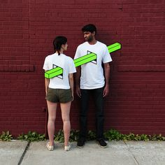 Artist 'Skewers' People Together With Optical Illusions Of Neon Geometric Shapes - DesignTAXI.com