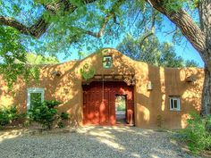 Southwestern Home ~ an adobe wall for the street-side...perfect