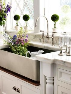 Love-farmhouse sink, marble countertop/splash, ledge windowsill.  Dislike-so many crevices/recesses to try to keep clean...in a kitchen.  I need EZ!