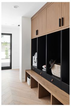 Modern Black and Walnut Drop Zone Dropzones are the perfect catch all for the clutter of daily life. This modern style storage area is not only beautiful with it's black and walnut cabinet design, it is totally functional for keeping the home organized. Mudroom Cabinets, Mudroom Laundry Room, Bench Mudroom, Entryway Cabinet, Drop Zone, Custom Home Builders, Custom Homes, Home Staging, Building A House