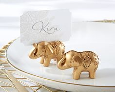 Gold elephant place card holders are an elegant touch to an Indian or South Asian wedding. | MyWeddingFavors.com