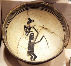 Mimbres bowl showing woman with parrot (c1100) from Mogollon southern New Mexico at Millicent Rogers Museum. Taos, NM.