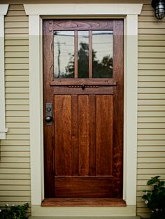 A Craftsman-style door of Spanish cedar and antique glass.
