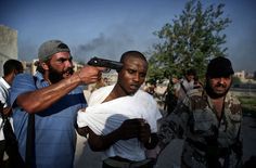 World Press Photo, Rebels capture an alleged mercenary in Tripoli, Gaddafi was accused of hiring armed support from other African countries World Photography, Photography Awards, Fantasy Photography, World Press Photo, African Countries, World History, Black People, Barack Obama, Brave