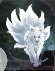 White kitsune walking on a tree branch.