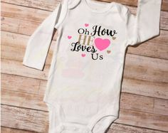 Cute Little Outfit! Perfect Inspiration for mom and dad when looking at their beautiful lil one!  This listing is for a white bodysuit with a Black/Gold glitter design. Quote: Follow Your Bliss with an arrow.   This item is made using super soft, 100% cotton bodysuits made by Carters. They come in short sleeve (SS) or long sleeve (LS). The skirt is made from Soft Black Tulle with gold dots.  The design is cut in a smooth heat transfer vinyl and applied to the bodysuit using a commercial ...