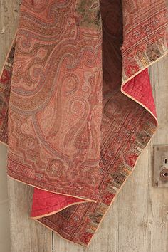 Antique French paisley shawl quilt ~ 19th century textile ~ wonderful red damask backing ~ www.textiletrunk.com