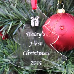 Unusual personalised gift for a baby's first Christmas Perfect to show how much you love them Attractively engraved quality clear acrylic - precision laser cut Also includes a Christmas present icon & the year FREE 1st class postage (UK only)