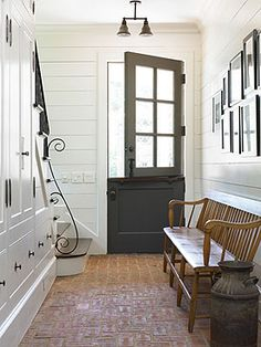 Love the Dutch door!This mudroom with it's brick flooring reminds me of old English stables with their brick flooring and dutch doors. It's ultra cool and a subtle transition from the barn into the heart of the home. Dutch Door, Home, Brick Flooring, New Homes, House, Brick Kitchen, House Interior, Ship Lap Walls, Character Home