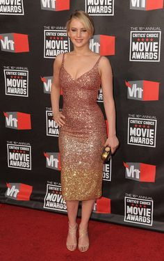 Critics' Choice Awards Fashion Retrospective: The Hunger Games' Jennifer Lawrence donned a body-conscious ombre sequin L'Wren Scott dress and Jimmy Choo heels in 2011.