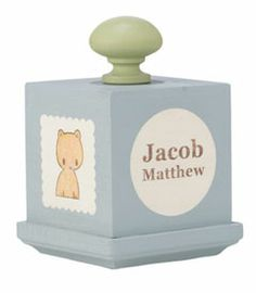 """personalized music block - this beloved heirloom is both decorative and functional. the music block plays Hush Little Baby, and features baby's name and birthdate on one side and initial on another. 4"""" x 3"""". handmade in USA."""