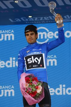 Spain's Mikel Landa of team Sky celebrates the Blue jersey on the podium of the 100th Giro d'Italia, Tour of Italy, cycling race after the last stage, an individual time-trial between Monza and Milan, on May 28, 2017. .Netherlands' Tom Dumoulin of team Sunweb won the 100th edition of the Giro d'Italia in sensational style on Sunday to make history as the first Dutch winner of the three-week Italian race / AFP PHOTO / Luk BENIES