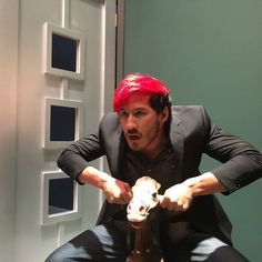 Markiplier, on a hobby horse!  The look on both their faces