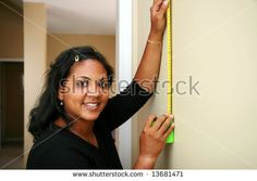 Woman measuring in the kitchen