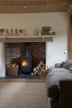 baskets, firewood, brick woodstove, mantle