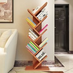 On the hunt for a cool bookshelf idea? Check out this modern wooden tree book rack.