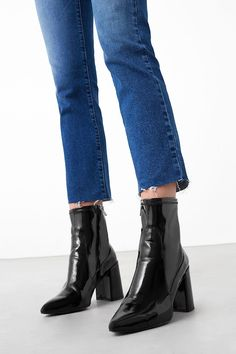 Photo via: Mango It's no secret that our love for patent skirts has been huge this season and now we have a new obsession with patent ankle boots. We've found 15 of the coolest pairs to shop now. Get