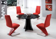 Titles like 'elite, bold, #fashionable' will be given by your guests, when you buy this super luxurious contemporary black round #dinningtable with red 4 chairs.