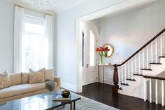 Park Slope Brownstone - entry and living room with dark stained floors and pale walls