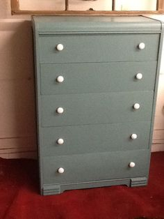 Old dresser refinished in aqua, and white.