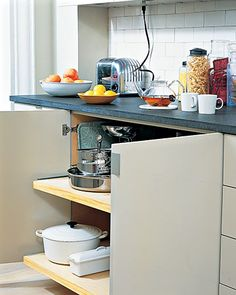 Under-counter cupboard storage for bulky pots and pans