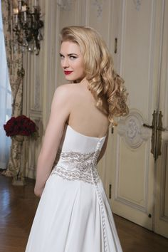 2015 Justin Alexander wedding dresses style 8772 Chiffon ball gown embellished with a strapless neckline.