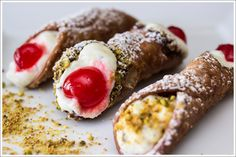 Cannoli from Palermo is garnished with a cherry, and from Catania with a dash of pistachio.