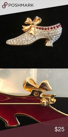 Authentic Swarovski Crystal Brooch A brooch styled in the likeness of high heeled lady's shoe made of silver crystals highlighted in red crystals along its top with a bow. Swarovski Jewelry Brooches