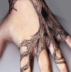 Spooky tree tattoo on hand
