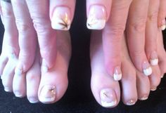 French tip with gold glitter line and metallic gold maple leaf.  Fall nails.