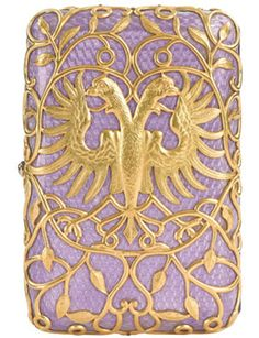 Cigarette-case presented by Empress Alexandra to her husband Nikolay II in May 29, 1897 to commemorate the birth of their second daughter Tatiana. Made by jeweler August Holstrem of The Faberge House, from gold and enamel of lilac color, that Alexandra liked most of all.