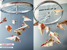A used #bike wheel and paper airplanes.   A great #DIY decoration.