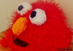 How to make an Elmo ear flap hat using a round Knifty Knitter loom.