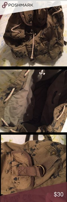 AEO backpack purse American Eagle backpack purse. It closes with a drawstring and has a flap that snaps shut with a magnet over top. There is a front pocket and a small pocket on each side, and inside pockets to tuck small things into. It holds ALOT of stuff! The only flaw is a small tear on the bottom (see last photo) but it is not even close to all the way through into the purse. Make me a reasonable offer! American Eagle Outfitters Bags Backpacks