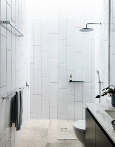 Classic rain head shower in this modern bathroom / point lonsdale home