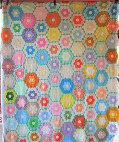 """Pretty GRANDMOTHERS FLOWER GARDEN Vintage by AntiqueQuiltRevival.  Another 60s polyester find. I don't think this will resonate with quilting purists, but as some quilters attest, many many quilts were """"make do"""" projects created with the supplies at hand....so, double knit was popular in the 60s and this was probably comprised of used clothing and scraps back when sewing was a standard activity for women and girls."""