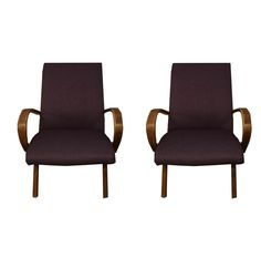 A pair of Mid Century Modern bentwood arm chairs by Jindřich Halabala, a Czech designer. The dark stained, bentwood arms match the tapered legs. The chairs are upholstered in a purple fabric. Purple Fabric, Dark Stains, Mid Century Modern Furniture, Armchairs, Mid-century Modern, Accent Chairs, Design, Home Decor, Dark Spots