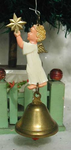 West German Plastic Angel Ornament with Brass Bell.