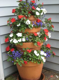 How to Make A Terra Cotta Pot Flower Tower with Annuals. Take container gardening to the next level…go vertical! This easy to make flower tower can dramatically enhance vertical space with vibrant summer long color. Supplies Needed Lawn And Garden, Garden Art, Home And Garden, Herb Garden, Garden Planters, Balcony Garden, Tower Garden, Flower Planters, Porch Planter