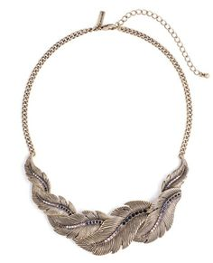 Stunning Feather Statement Necklace encrusted with jet black, clear and smoky-colored crystals.