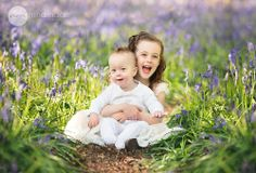 Baby and sister in bluebells www.ninamacephotography.com