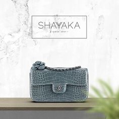 Chanel Shiny Alligator Flap Bag with a Calfskin Camellia | Spring/Summer 15 | 11 x 18.5 x 5 cm | Pre-Order Now  For purchase inquiries, please contact sales@shayyaka.com or +961 71 594 777 ( SMS, WhatsApp, or iMesasage) or Direct Message on Instagram (@Shayyaka). Guaranteed 100% Authentic | Worldwide Shipping | Bank Transfer