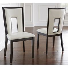 Bring your dining room up to date with the contemporary style of these Domino side chairs. Featuring a keyhole back design and easy to clean, white vinyl seats and backs, these chairs will add modern