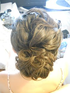 Wedding Hair Bride or bridesmaid sophisticated soft curly updo styled by Carrie at Appease Inc.    Need a stylist for your wedding?  We travel anywhere!  Visit our website for details.