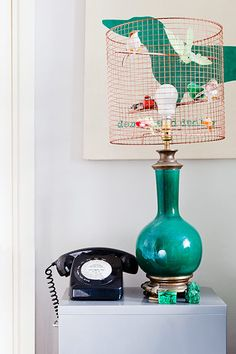 """The pair made this shade from chicken wire and dowels, sprayed it copper and bought the birds separately. They found the lamp base for £10 at Spitalfields market, east London."" (Guardian Weekend)"