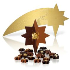 A truly spectacular chocolate experience, our dazzling Shooting Star statement box created specially for Christmas 2013, filled with 23 milk and dark chocolate star-shaped pralines and a supernova star of milk chocolate and feuilletine and salted caramel éclat, all adorned with a gold leaf design. #hotelchocolat #hcdreamhamper