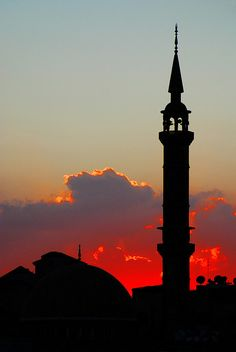 Amman, Jordan The architecture and the beautiful color of this sunset makes this such a lovely picture. :)