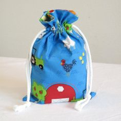 """Drawstring gift bag using Farm Friends fabric by Jamie Wood, sold on Etsy by """"GoosesBagsandGIfts"""""""