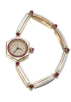 LADY'S RUBY AND DIAMOND WATCH, 1920S The circular dial applied with Arabic numerals and blued steel hands, the bezel set with calibré-cut rubies, to a bracelet of sprung baton links decorated with white enamel, between cabochon rubies, length approximately 150mm, French assay marks.